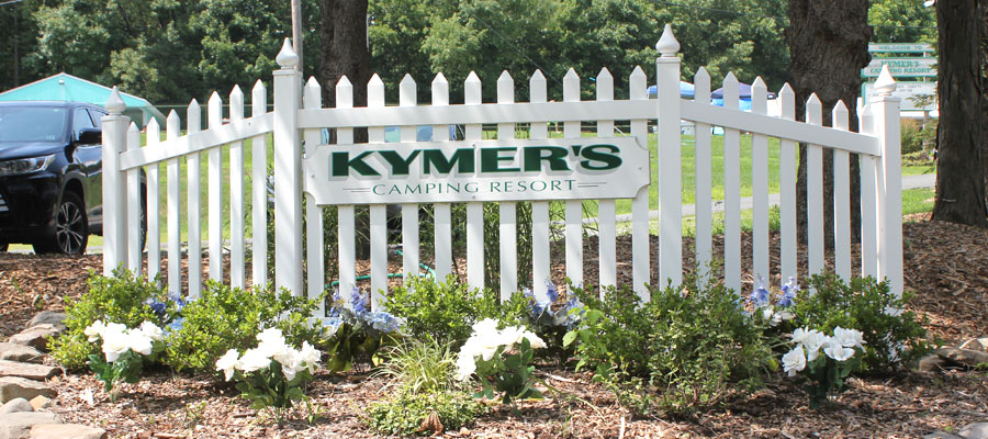 A picture of the Welcome to Kymer's sign
